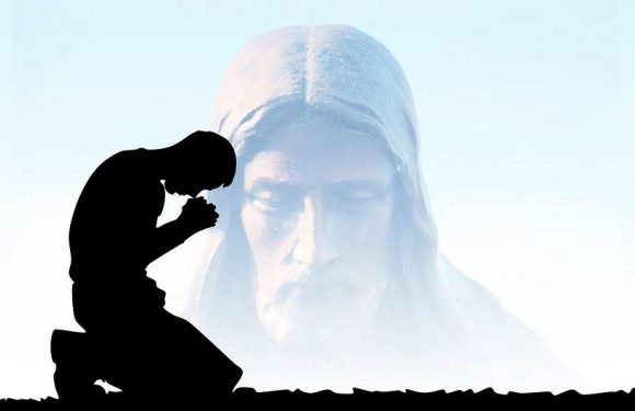 Faded image of Jesus bending down while person prays