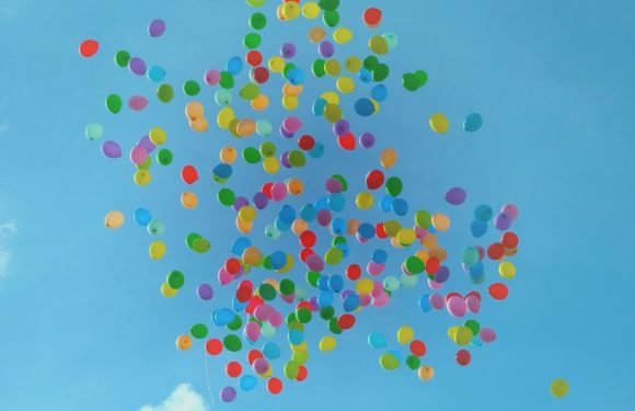 Brightly colored balloons in the sky