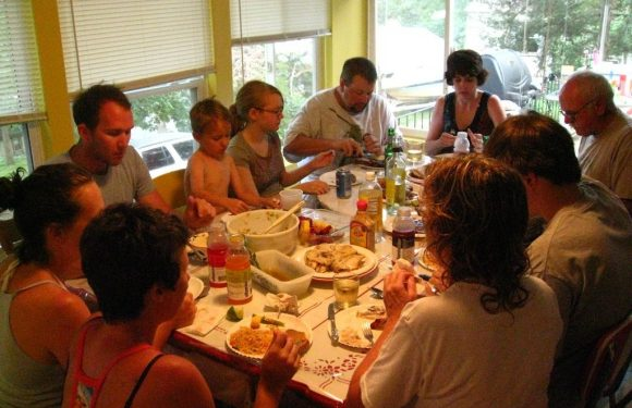 Family praying before a meal