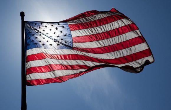 US Flag with sun shining through