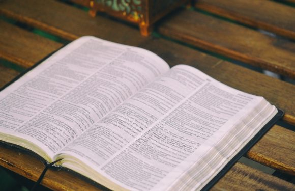 Bible lying open on a desk
