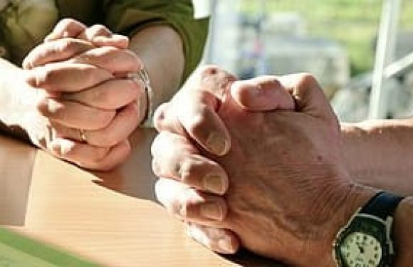 Man and woman with Hands folded for prayer