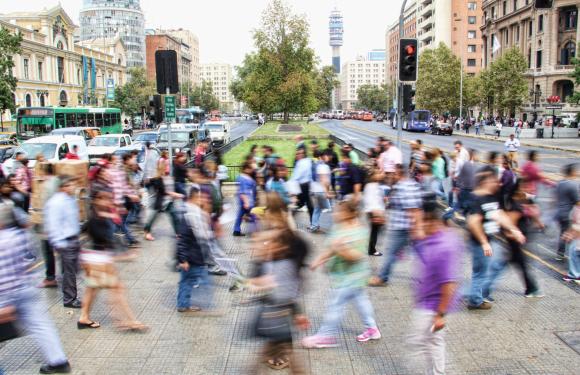 blur of busy people in the crosswalk