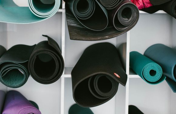 Yoga mats stored on a shelf
