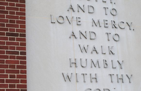 """Micah 6:8b on a cement wall. """"and to love mercy, and to walk humbly with thy God."""""""