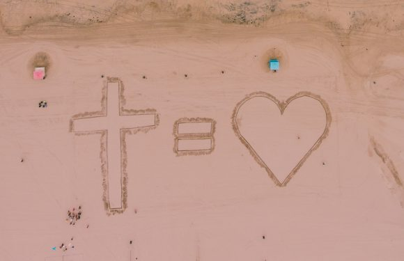 Cross = Heart (drawn in the sand)