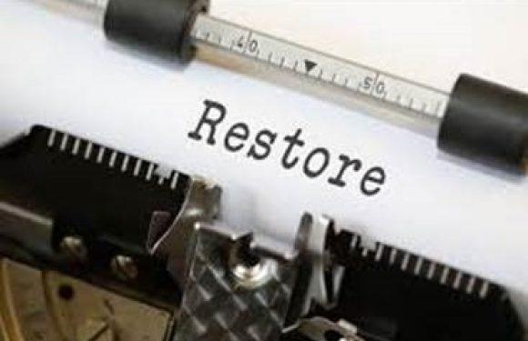 Typewritten word Restore on paper in typewriter