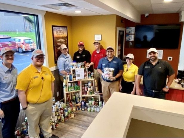 North Liberty Staff with Canned Good Donations