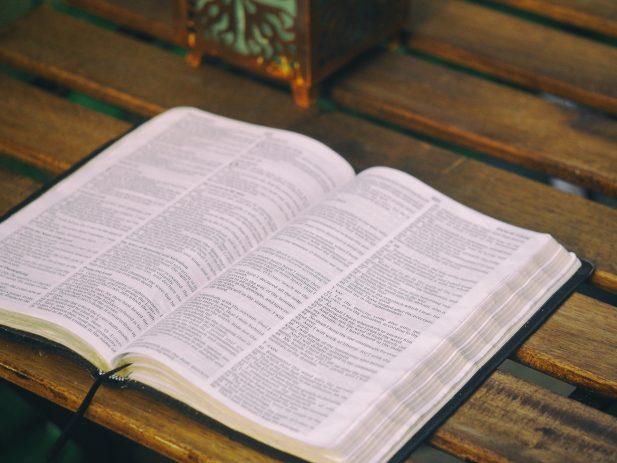 Bible lying open on a desk