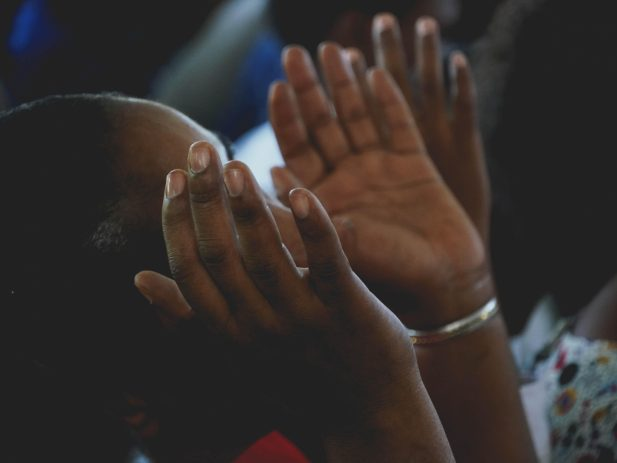 Woman lifting hands in worship