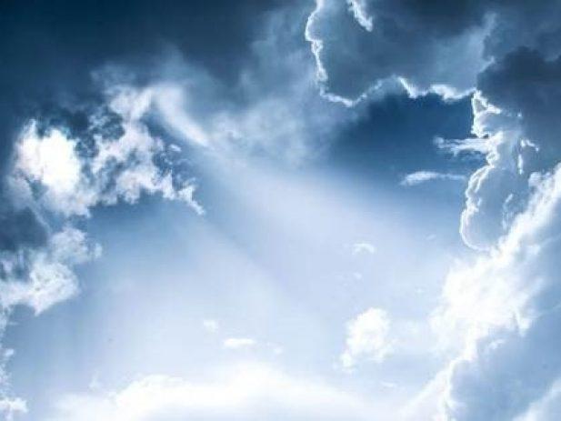 Sun rays shining through dark clouds