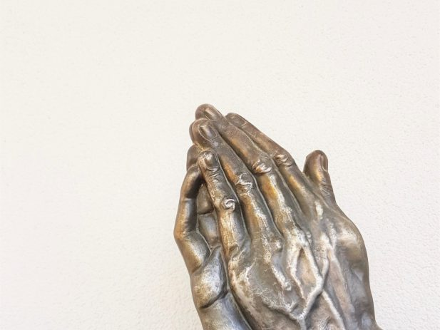 praying hands of a statue