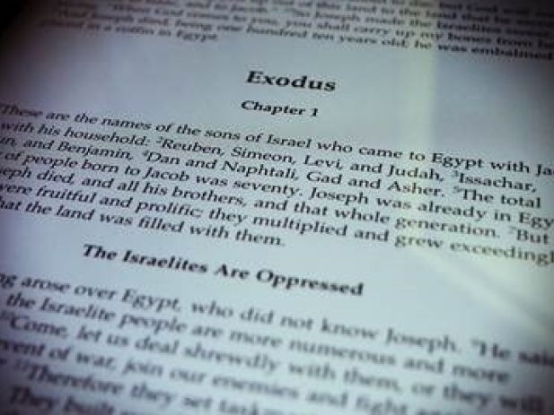 Bible open to Exodus 1