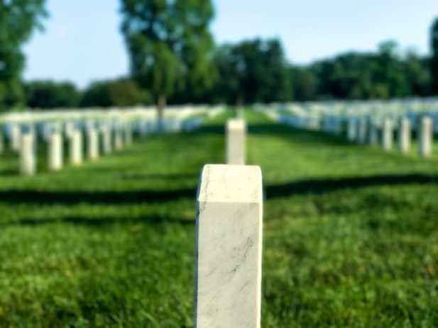 Photo of military headstone in graveyard by Forrest Smith on Unsplash