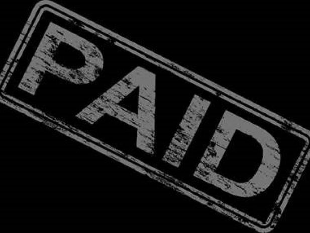 Stamped word saying paid