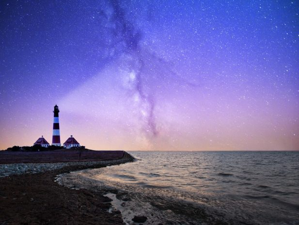 Lighthouse projecting light into the night