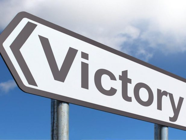 Street sign that says Victory
