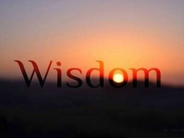 Sunset with word wisdom on the sky
