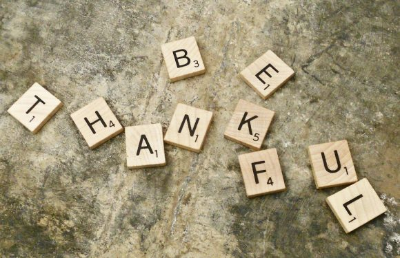 """Scrabble Letters spelling out """"Be Thankful"""""""
