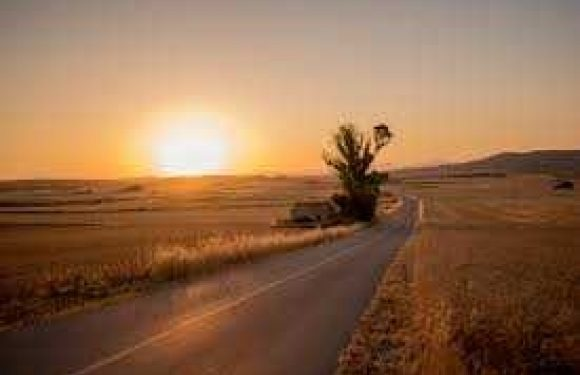 Sun rising over the road, new day and new path