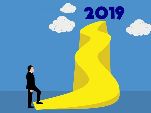 Long uphill sidewalk with 2019 at the top