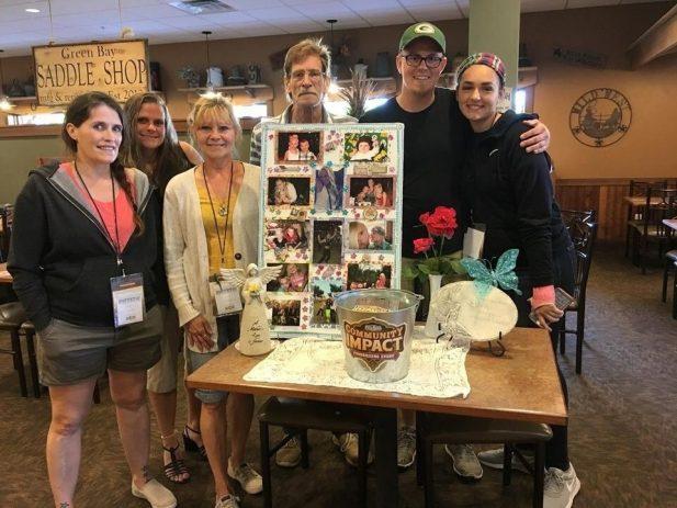 Nicole's family with a table of memorabilia