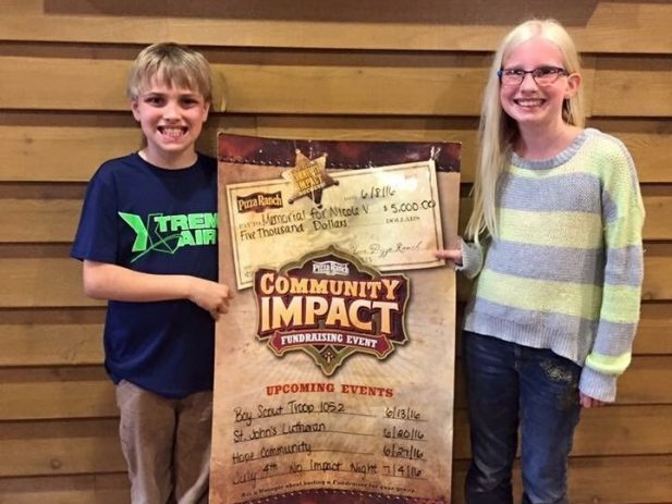 2 of Nicole's kids with their impact day earnings check