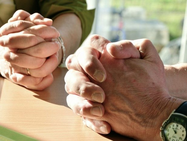 folder hands in prayer