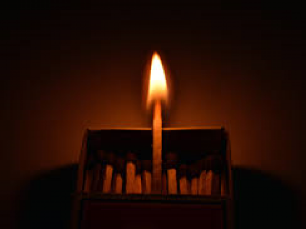 Single Match Burning in a box of matches
