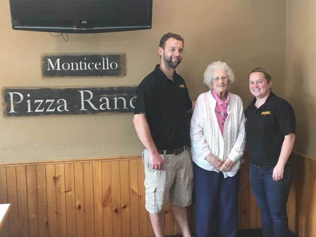 Monticello managers with a longtime guest
