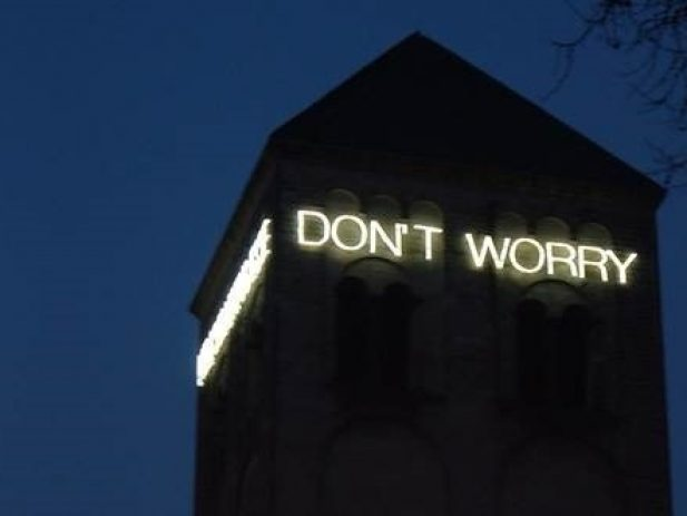 Don't Worry lights on a building at night