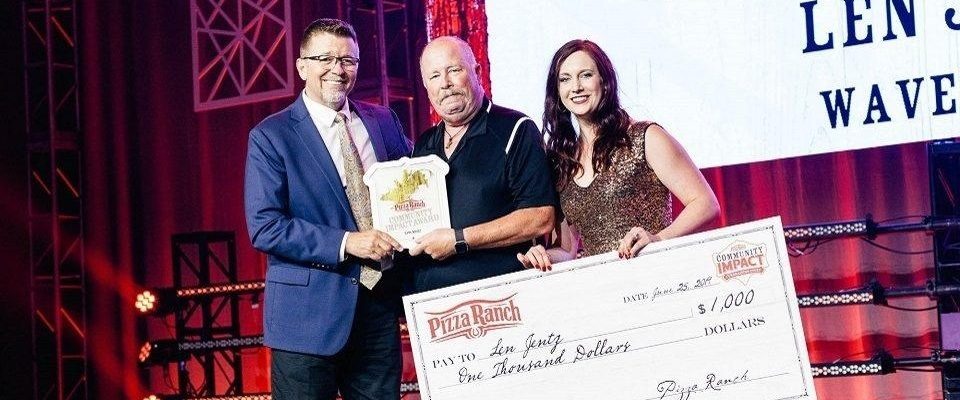 Len Jentz receiving award at Pizza Ranch National Conference